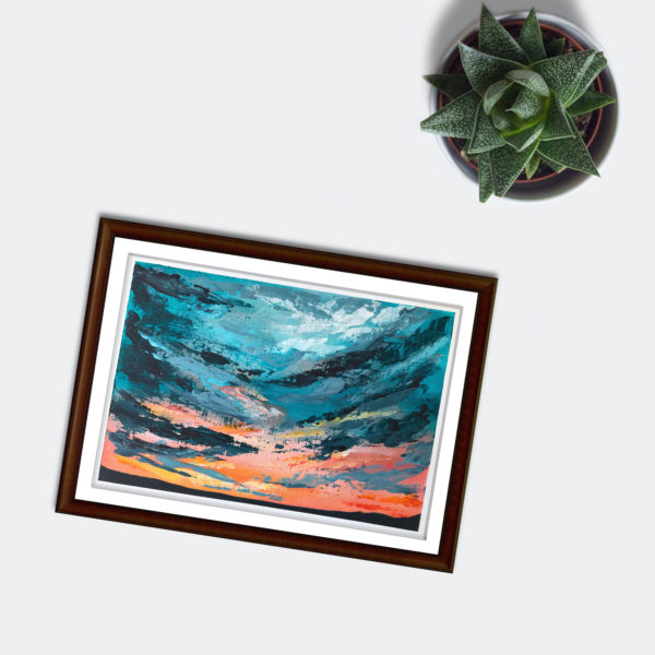 painting in a brown frame of turquoise skies next to a small house plant