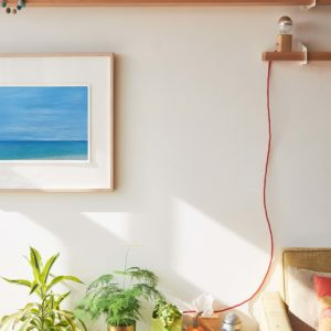 tropical beach painting in bright room
