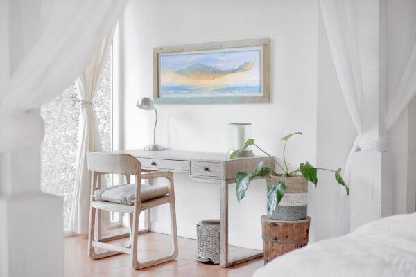 painting in wooden frame in light room