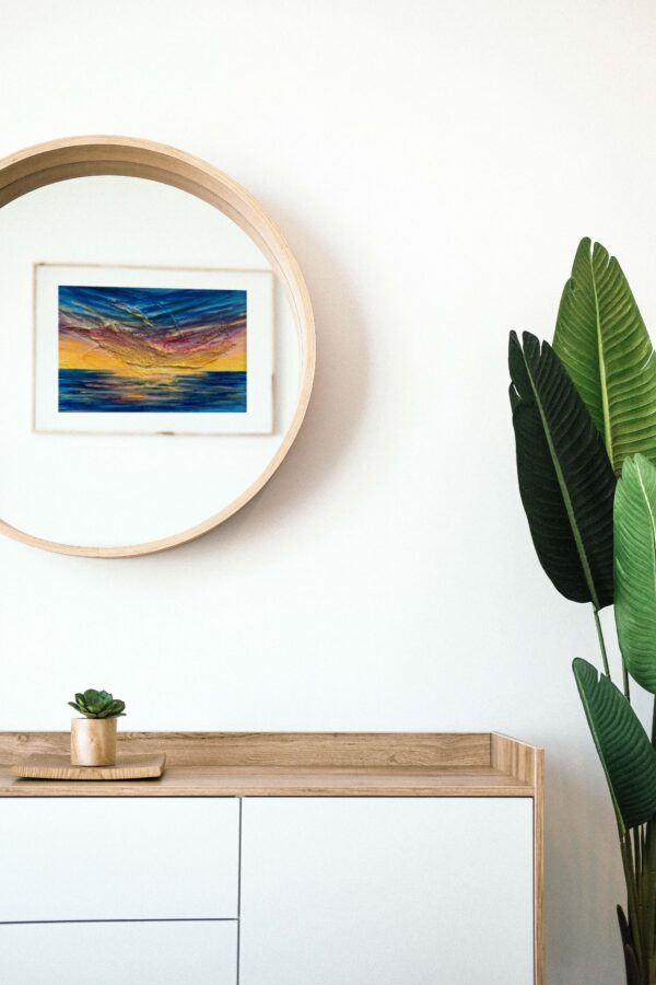 vibrant acrylic sunset painting in mirror reflection