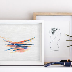 minimal ink painting in frame on white shelf